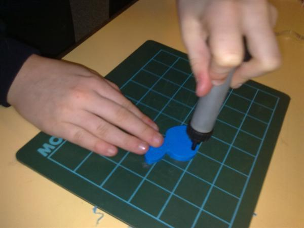 Using the hole punch