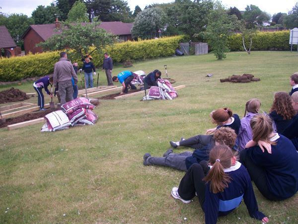 The eco councillors watching the garden take shape
