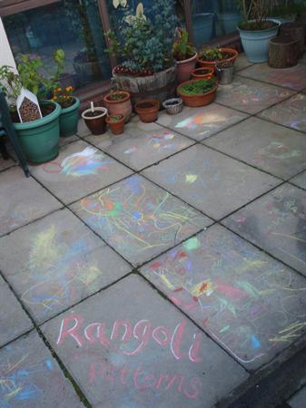 Rangoli patterns in the courtyard.