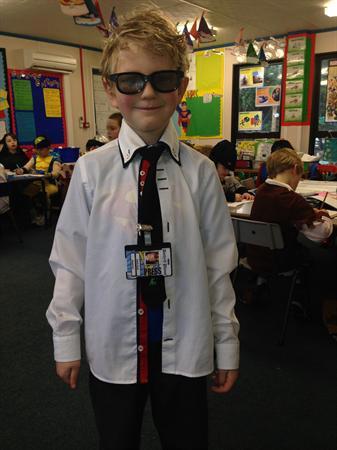 Oliver is dressed as Clark Kent AKA Superman!