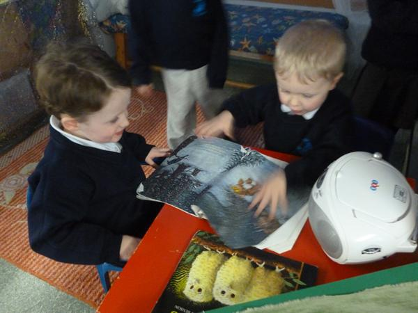 Sharing books and listening to stories.
