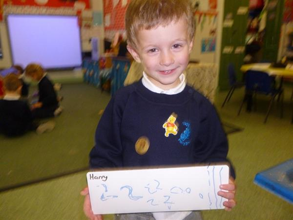 Learning to write numbers 0-3.