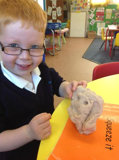 making faces in the play-dough