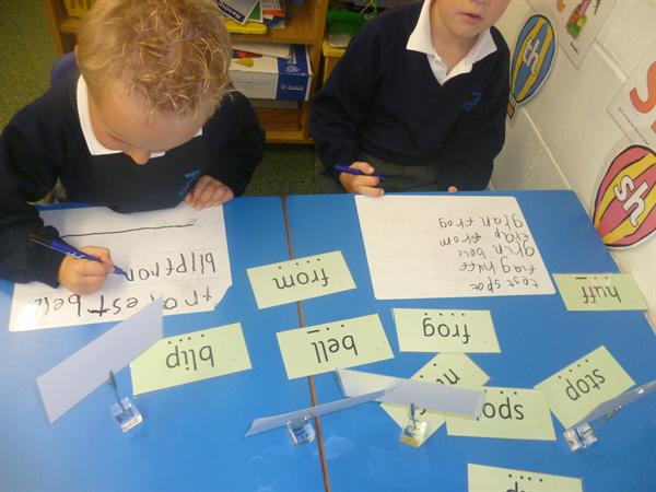 LLC- reading CCVC words & letter formation.