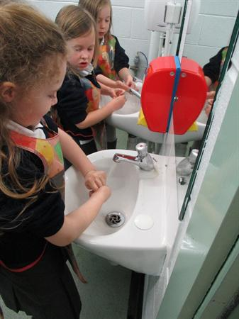 Making sure we wash our hands properly!