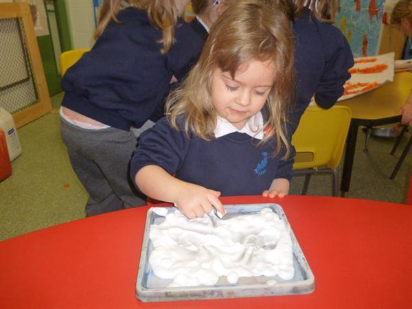 "Using shaving foam to form ""m."""