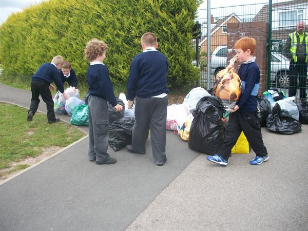 Moving the clothes from the bike shed!