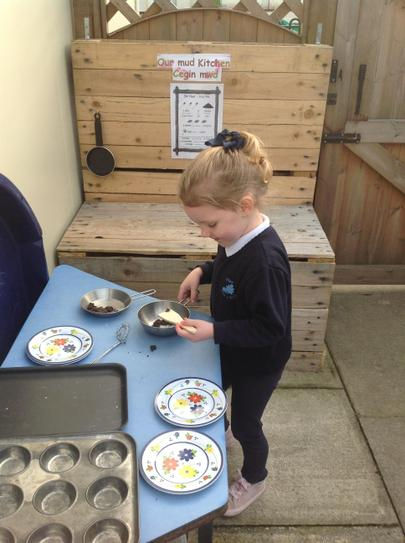 fun outside in the mud kitchen.....