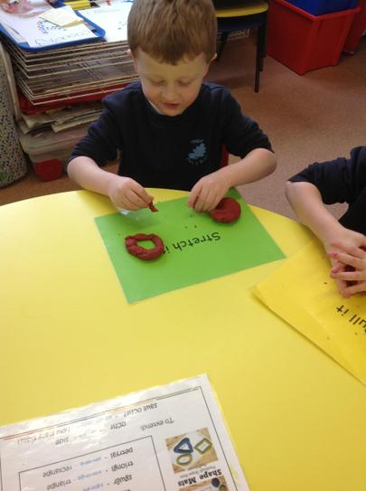 making shapes with play-dough