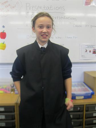 Wearing a black cassock
