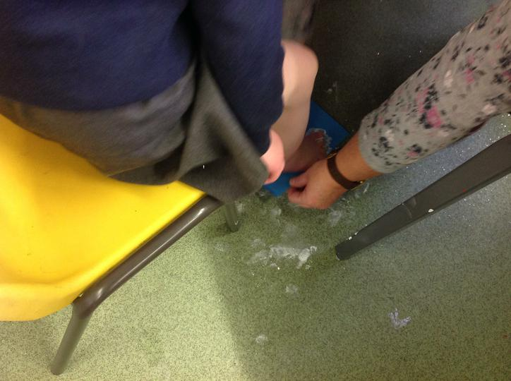 Printing our feet on to blue card