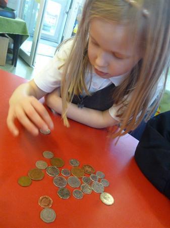 Maths- matching coins...