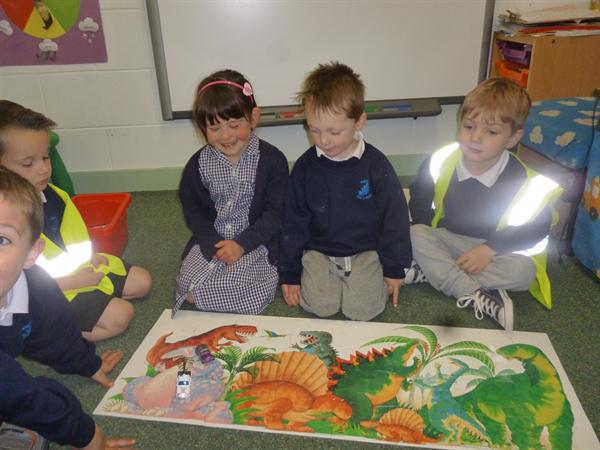 Working as a team to complete a dino jigsaw!
