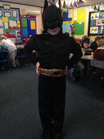 Kai is dressed as The Dark Knight Batman
