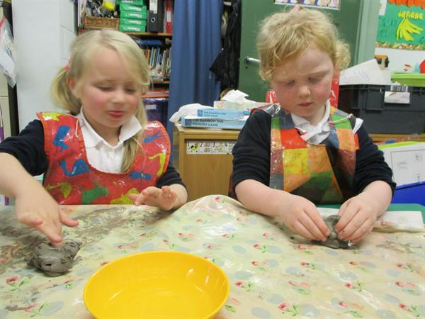 Making our diya lamps with clay.