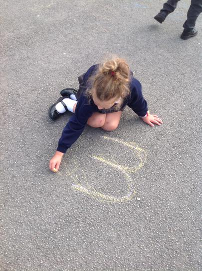 """Practising our sounds outside using chalk""""m m m"""""""