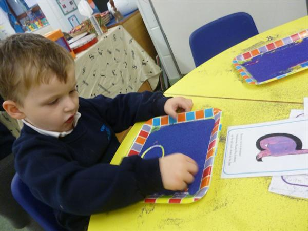 Writing in sand trays- 'd'