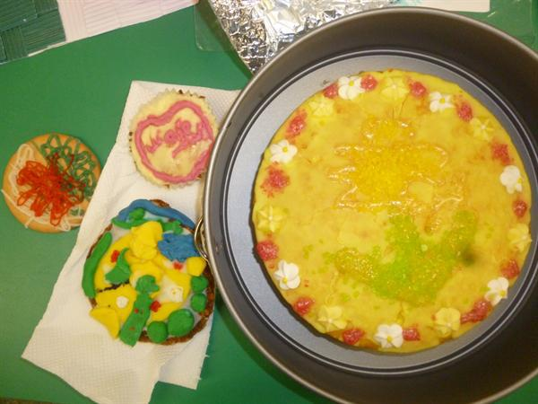 Decorated cakes and biscuits.