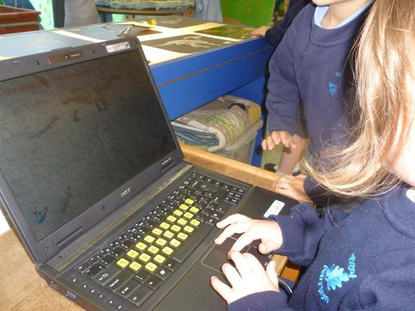 A dinosaur puzzle on the laptop