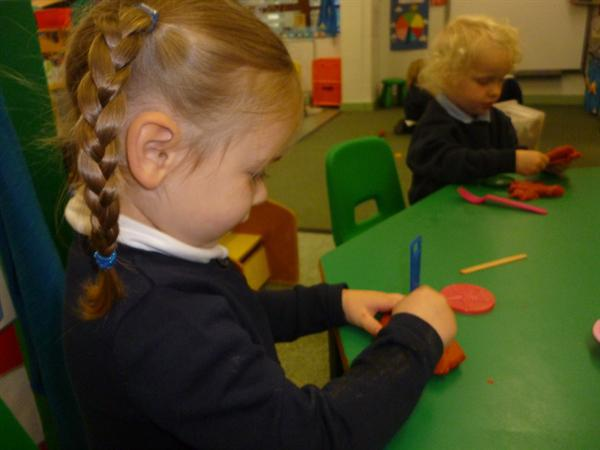 Using tools with the playdough.