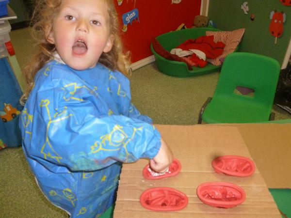 using plaster of paris to create dino moulds!
