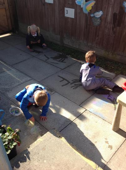 mark making outside with chalks and paint