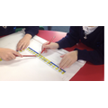 Using rulers to measure in cm.