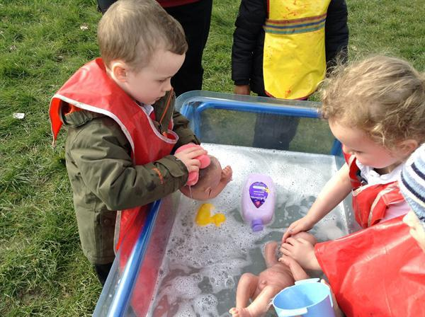Bathing the babies as part of our Welsh lesson.