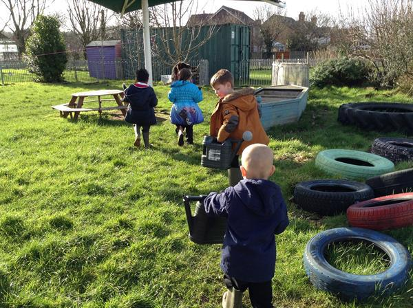 Watering the plants ( with Miss Vicci)