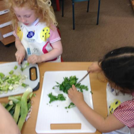 Preparing the vegetables and herbs.