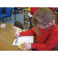 Practising writing letters in choosing time