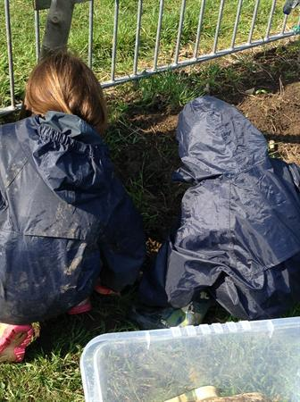 Nursery-making soup in the mud kitchen.