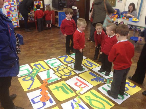 Playing giant snakes and ladders.