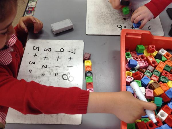 Addition using multi-link cubes.