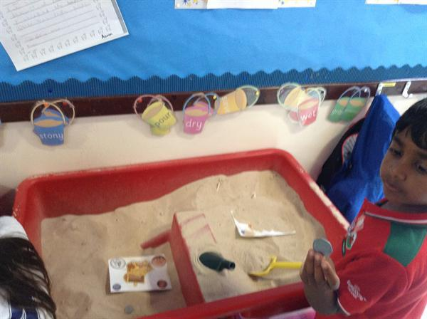 Finding and matching coins in the sand.