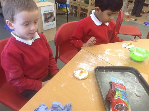 Decorating our biscuits.