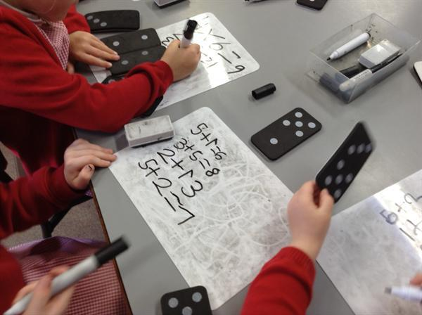 Using dominoes to make up our own addition sums.