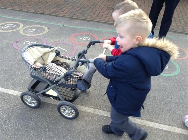 Working with a partner to push the pram.