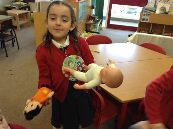 Lifting the babies to see which felt the heaviest.