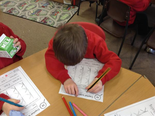 Practising our handwriting.