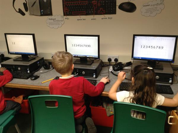 Number work on the computers with Mrs Harvey