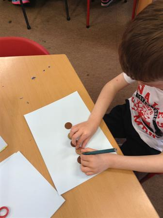 Money week- drawing around coins.