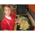 Practising our letters in the custard!