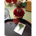 Decorating Christmas trees with playdough