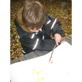 Mark making with sticks and paint