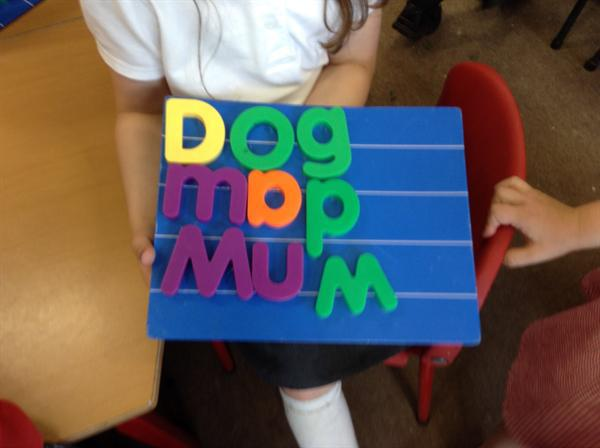 Making words with the magnetic letters.