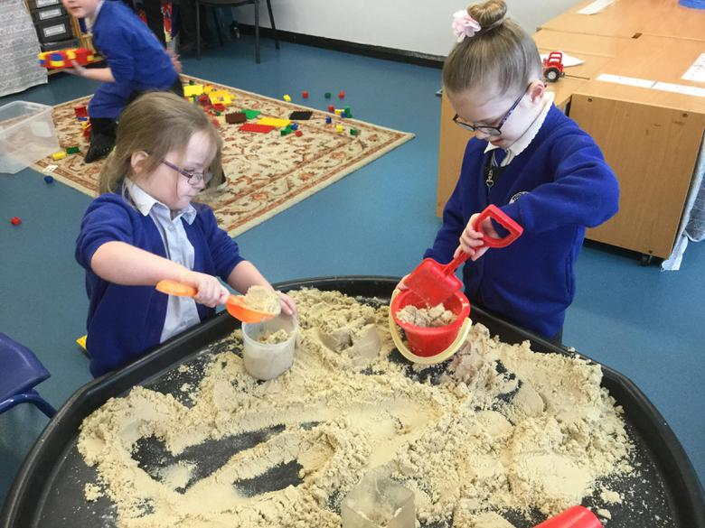 Estimating the number of scoops to fill our bucket