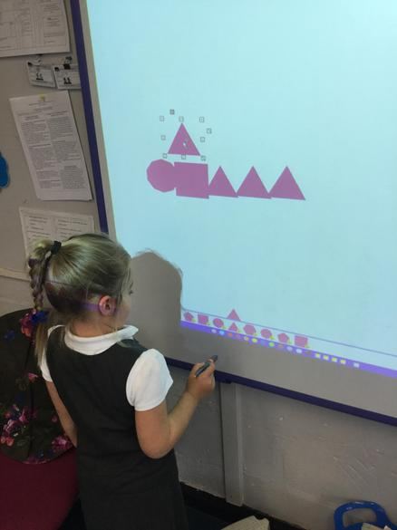 I made a shape dinosaur on the whiteboard.