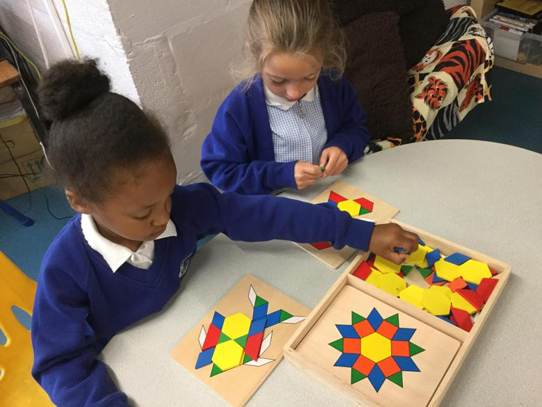 Working together to solve shape puzzles