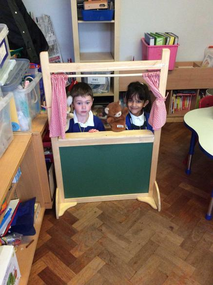 Performing a puppet show!
